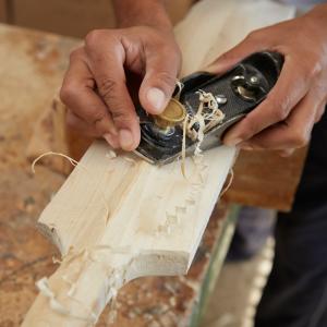 Hand-shaping and hand-crafting a cricket bat blade
